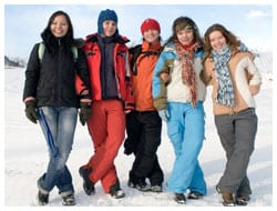 Five women posing for a picture in winter
