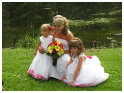 Bride posing for picture with flower girls.