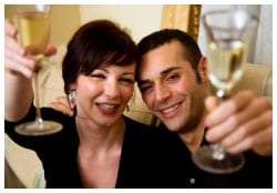 Man and woman toasting with wine glasses